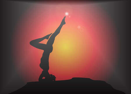 headstand: A yoga woman silhouette performing headstand pose on a dark colourful background with a glare