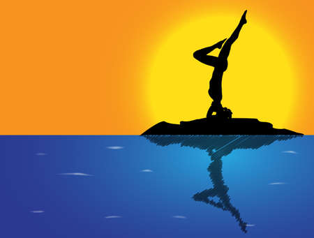 headstand: A woman silhouette performing a headstand on a rock in the sea