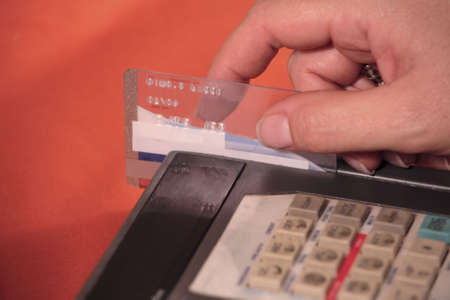 pos: Swiping a credit card on a POS machine.