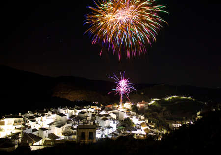 Fireworks in a little town in the mountains. Standard-Bild
