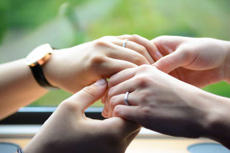 Four hands softly touching together