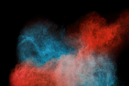 powder in different colours thrown into the air forming a huge cloud of smoke Stock Photo