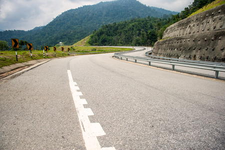 Empty road with huge mountain at the background