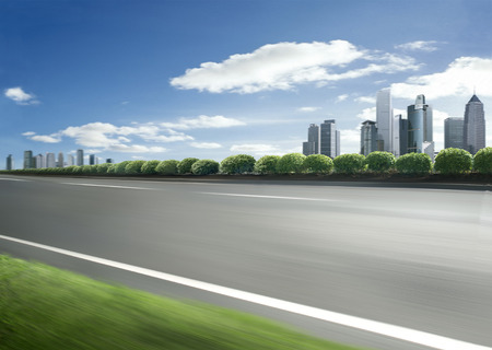 city skyline with foreground movement road scene
