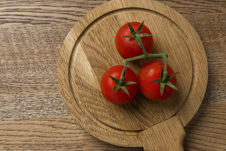 Fresh tomatoes presented on wooden nice texture background