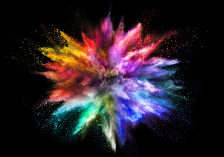 Explosion of rainbow colored powder, isolated on black background