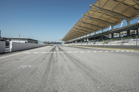 Empty background of racing track with grandstands Foto de archivo