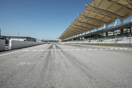 Empty background of racing track with grandstands Standard-Bild