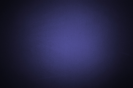 Blue colour paper with texture useful as a background vignetted and gradient background