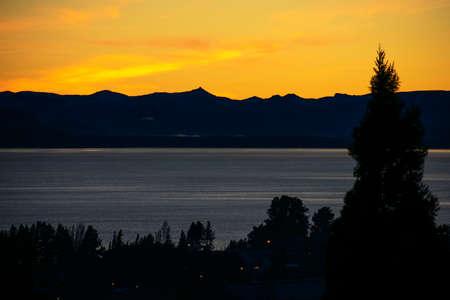 Sunset with yellow colors over Lake Nahuel Huapi, Argentina