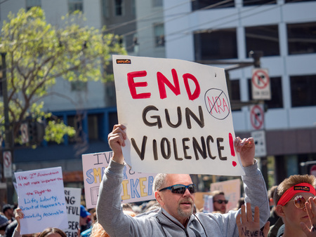 SAN FRANCISCO, CA - MARCH 24, 2018: End gun violence, anti NRA sign at March for Our Lives rally in San Francisco. The rally was one of dozens nationwide that was sparked by the Stoneman Douglas school shootings.