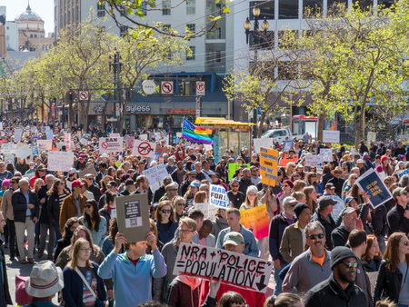 SAN FRANCISCO, CA - MARCH 24, 2018: Anti-gun and anti-NRA march at March for Our Lives rally in San Francisco. The rally was one of dozens nationwide that was sparked by the Stoneman Douglas school shootings.