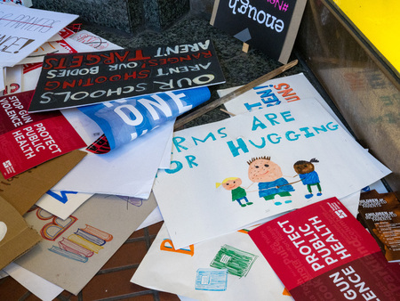 SAN FRANCISCO, CA - MARCH 24, 2018: Various discarded signs for the March for Our Lives rally in San Francisco. The rally was one of dozens nationwide that was sparked by the Stoneman Douglas school shootings. Signs are pro-peace, anti-gun, and anti-NRA i