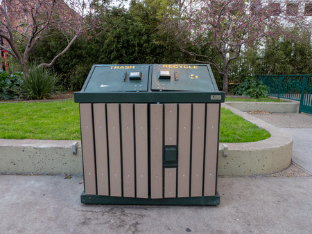 Trash and recycle bin in park Imagens