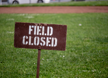 """Field closed"" sign blocking access to a field in a park outside Stock Photo - 99611947"