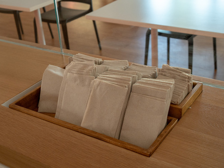 Row of napkins and paper towels to be used on display in a cafeteria 写真素材