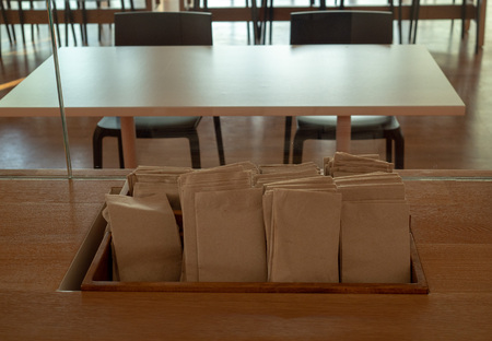 Front view of napkins and paper towels on display in a cafeteria to be used