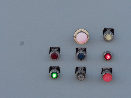 Switches and toggles on a control panel flashing various lights and labels Stock Photo