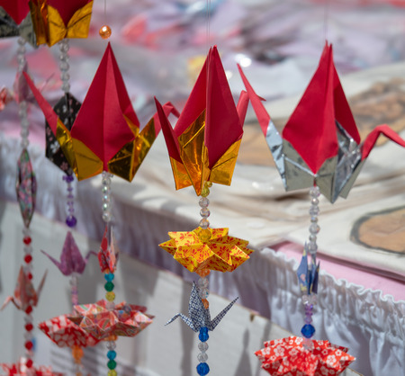Suspended crane origami figures decorating an outdoor market in the spring time Stok Fotoğraf