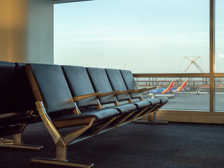 SAN FRANCISCO, CA – May 10, 2018: Empty seats at SFO airport with Southwest planes in background Stock Photo - 113679159