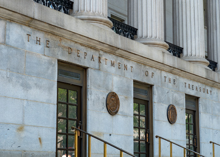 WASHINGTON, DC – MAY 15, 2018: Treasury Building entrance, headquarters of United States Department of the Treasury