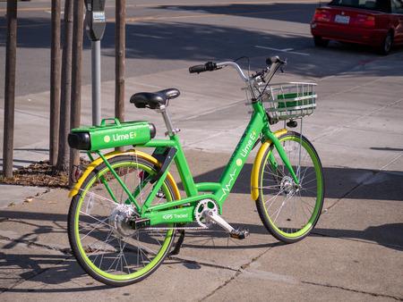 SAN FRANCISCO, CA – MAY 27, 2018: LimeBike, dock free electric bikeshare, e-bike parked in middle of sidewalk