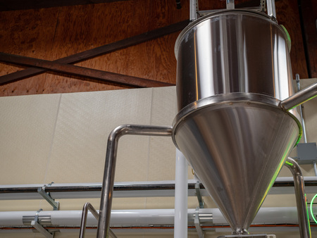 A cone shaped fermentation tank at a brewery Stock Photo