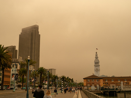 San Francisco Ferry Building on Embarcadero taken over by smog of nearby wildfires