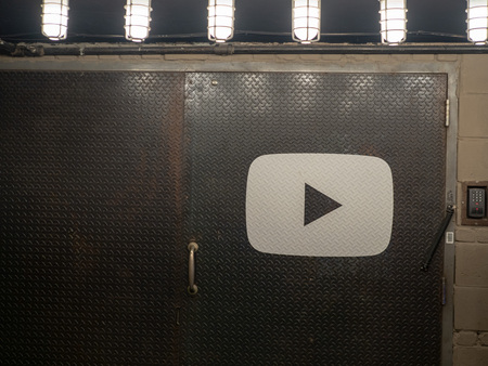 YouTube logo on steel door entrance to Chelsea Market location