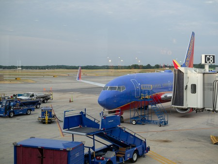 Southwest Airlines plane loading passengers Editorial