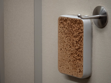 Tailor cork board on wall of dressing room for needles