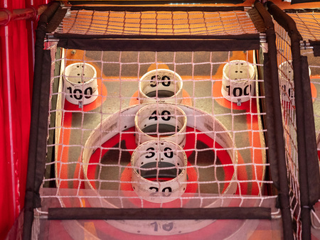 Scoring area of skee ball game behind a net with values of 10 to 100 스톡 콘텐츠