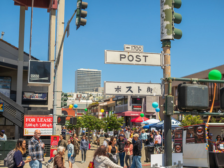 Post St sign in the heart of Japantown in San Francisco with a large crowd Editorial