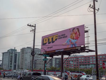 DTF Down to fall head over heels OkCupid online dating billboard advertisement
