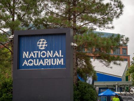 National Aquarium logo sign on the Baltimore Inner Harbor