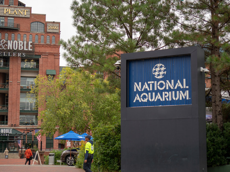 Entrance to the National Aquarium on the Baltimore Inner Harbor with Power Plant shopping plaza in background