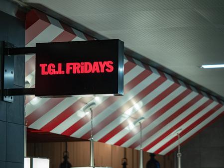 TGI Fridays banner logo at Hartsfield Jackson Atlanta International Airport Editorial