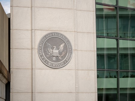 United States Securities and Exchange commission SEC logo on entrance of DC building near H street Sajtókép