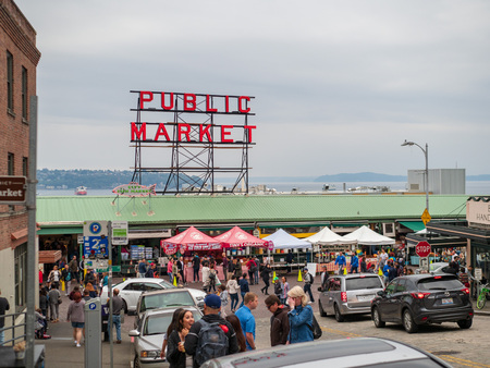 Pike Place Market, public market area with tourists roaming outside Editorial