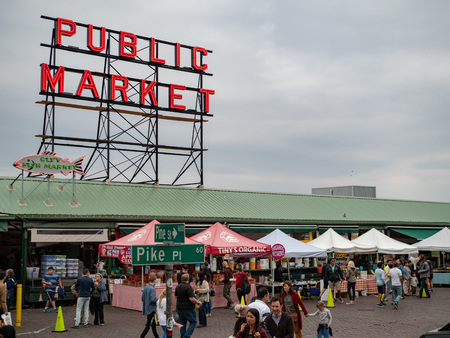 Pike Place Market entrance sign above Pike and Pine intersection street sign Editorial