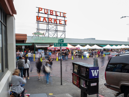 Pike Place Market outdoor fish market with tourists moving outside Editorial