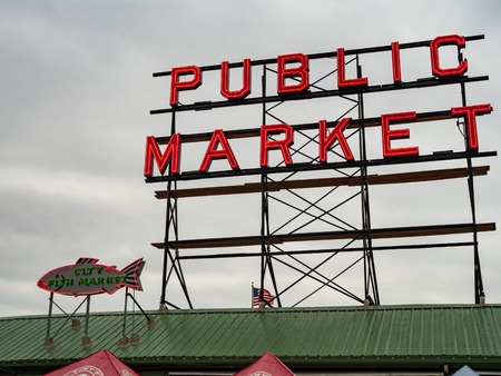 Public Market sign at Pike Place tourist spot with overcast sky