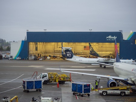 Alaska Airlines hanger and airplane at Seattle Tacoma International Airport terminal