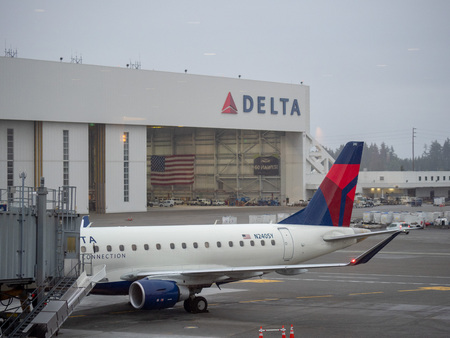 Delta Airlines hanger and airplane at Seattle Tacoma International Airport terminal