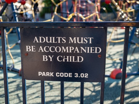 Adults must be accompanied by child park warning sign