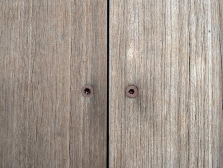Two rusty hex screws inside wooden boards Stock Photo