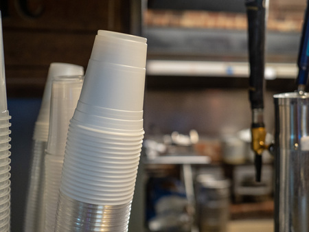 Paper cup dispenser leaning to right at a bar, copy space right Stock Photo