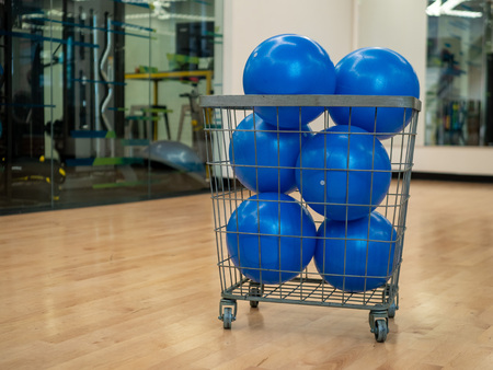 Basket with blue core exercise balls in an exercise studio