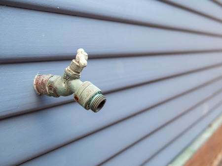 Faucet for garden hose attachment outside of house, rusty worn Reklamní fotografie