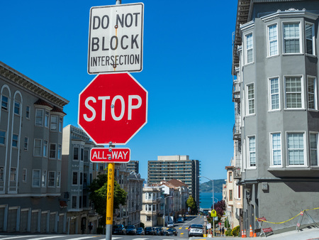 Stop sign do not block interaction hanging on post in urban city